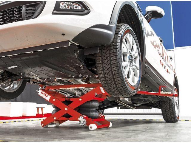 Table l vatrice ciseaux minilift de astra france - Garage mobile per auto ...